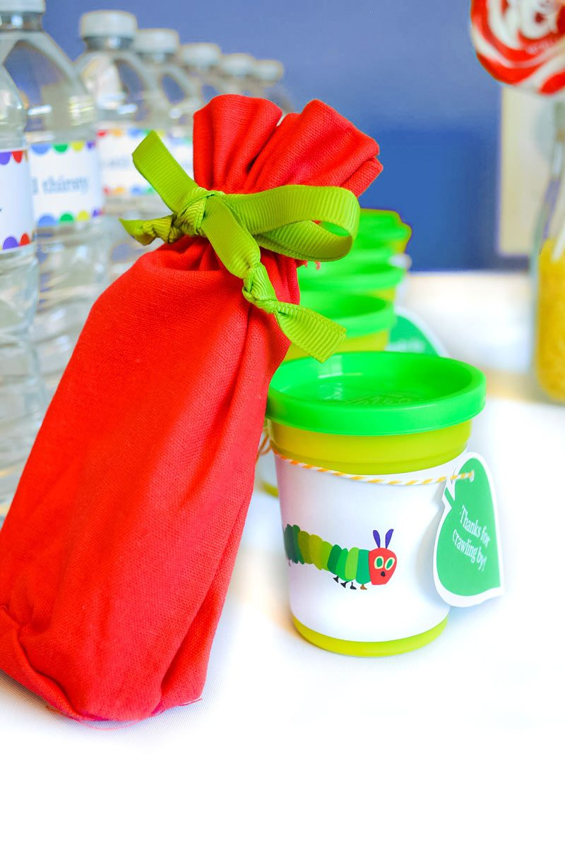 Find out how to create easy and inexpensive party favors for a Very Hungry Caterpillar themed birthday party.