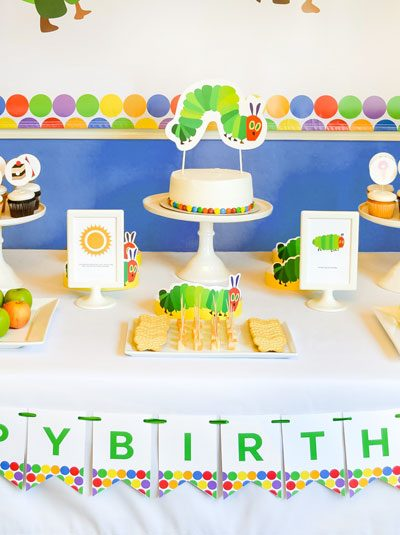 Be inspired by this modern and colorful Very Hungry Caterpillar party and download a FREE fill in the blank invitation for your own little one's party!