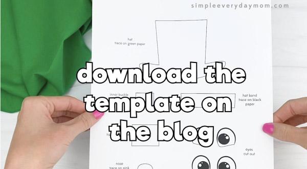 hand holding handprint leprechaun template