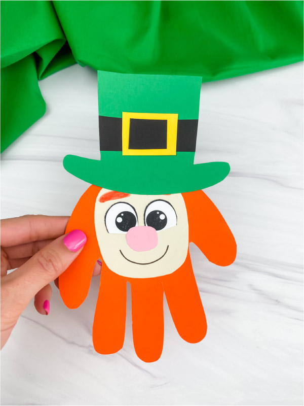 hand holding handprint leprechaun craft