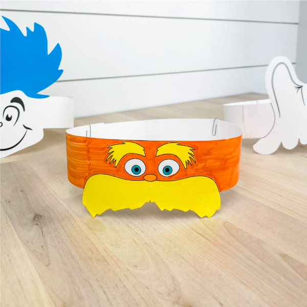 Colored in Lorax headband with Thing 1 and Horton headband in the background