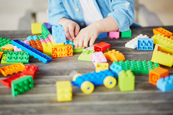 boy playing with lego duplo blocks