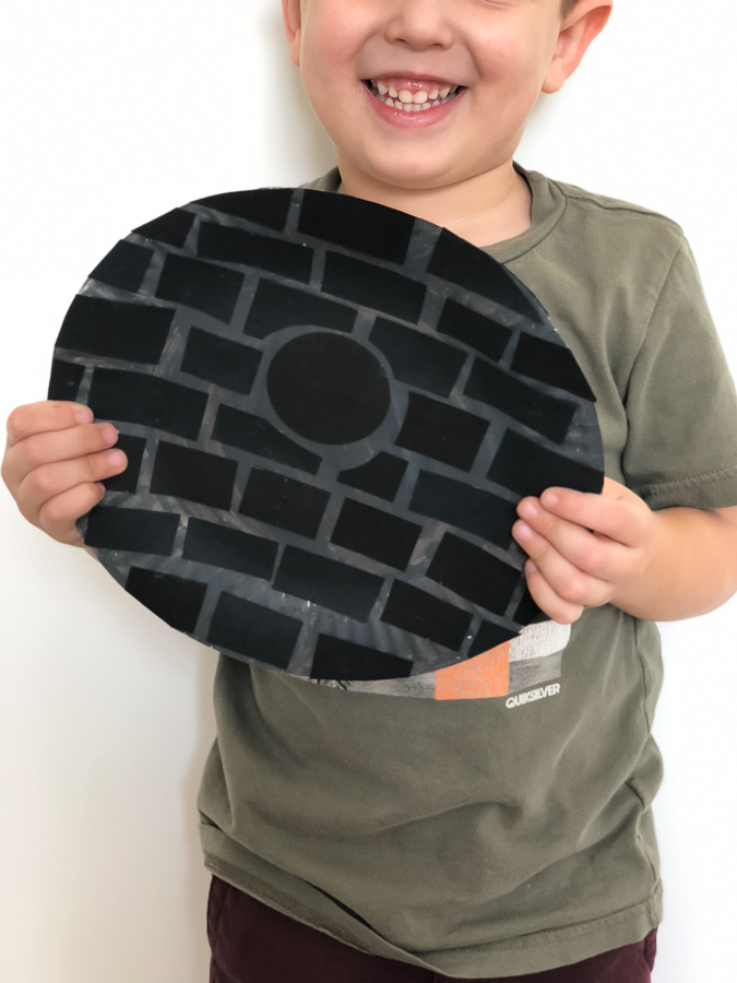 little boy holding paper plate Star Wars Death Star