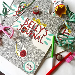 pregnancy journal with scissors, pencils, ribbon and accessories