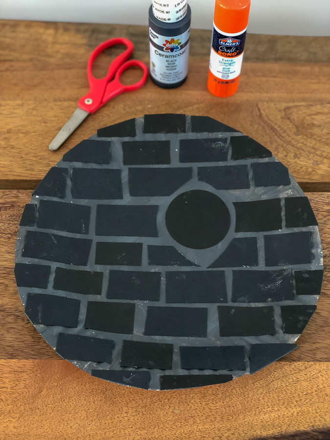 paper plate Death Star with scissors, glue, and black craft paint
