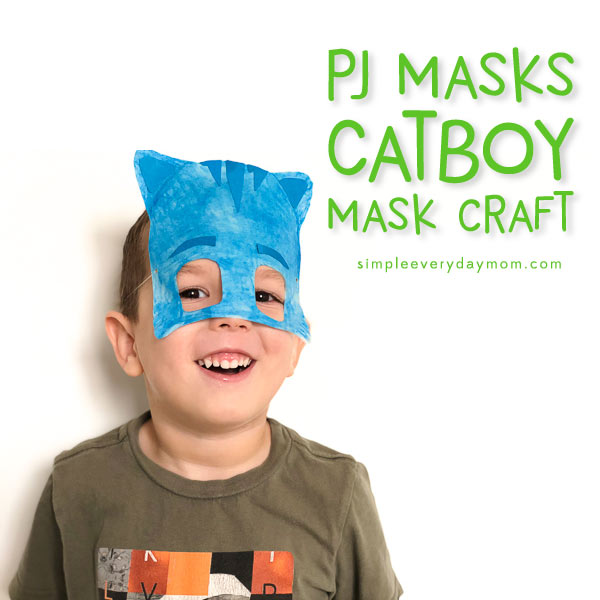 little boy with Catboy paper plate mask on