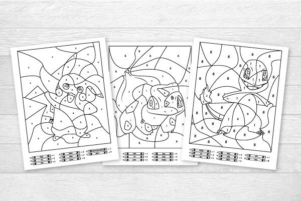 3 pokemon color by number worksheets on light wood backdrop