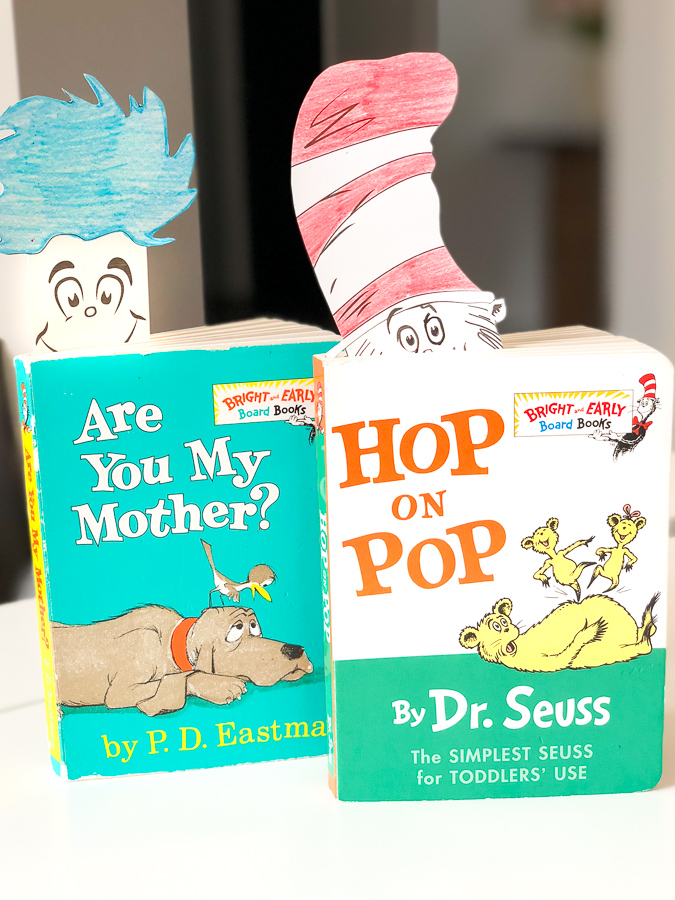 two dr seuss books with Thing 1 and The Cat in the Hat bookmarks
