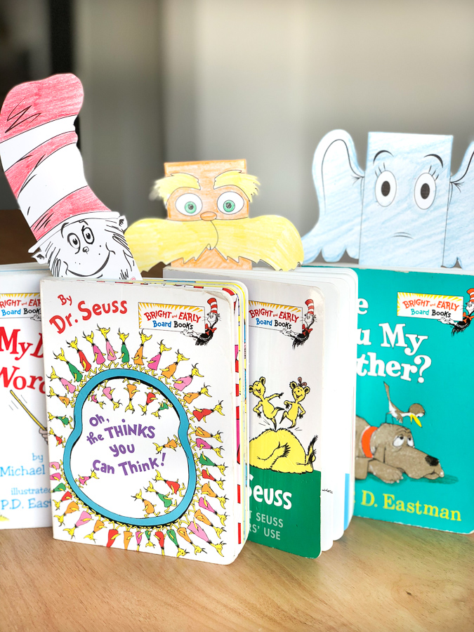 Four Dr. Seuss books with Dr. Seuss character bookmarsk