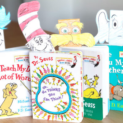 Four dr seuss books with dr. suess character bookmarks
