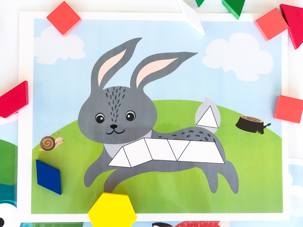 Bunny Pattern Block Mat | This bunny tangram mat is a perfect learning activity for kids. They work for preschool kids, kindergarten kids and pre-k children. Help teach math the fun way! #teachingmath #shapes #learningactivities #earlychildhood