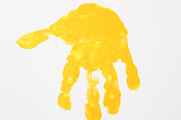Simple dinosaur handprint art for kids