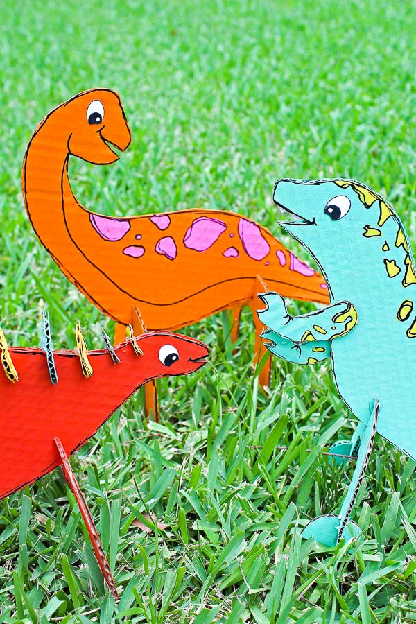 Recycled Craft For Kids | Make these fun and easy cardboard dinosaurs for creative play! #earlychildhood #kidsandparenting #kidsactivities #dinosaurs #kids #childrenplay #outdoorplay