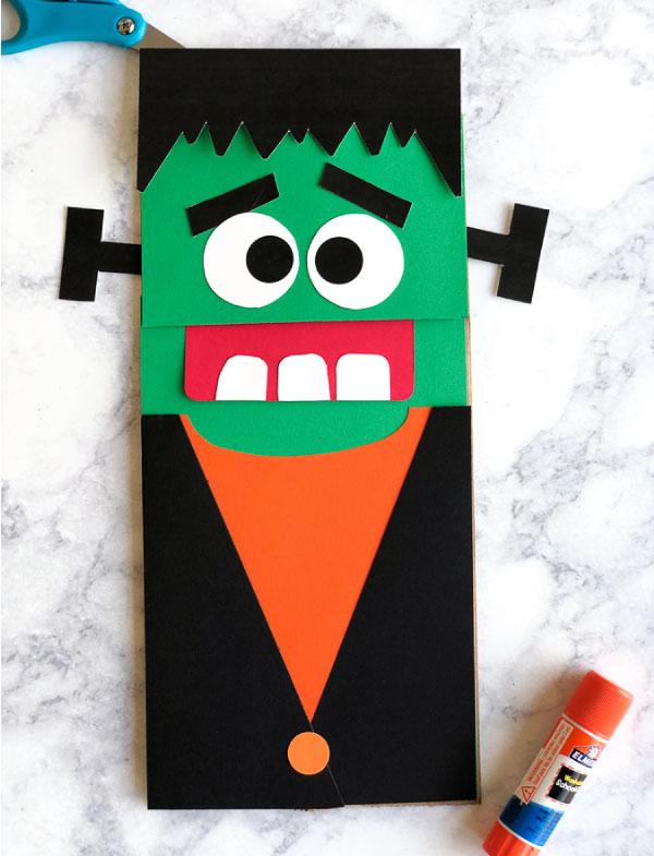Frankenstein Halloween Activity For Kids | Make this simple Frankenstein art that doubles as a fun puppet for kids! #kids #kidsactivities #halloween #halloweencrafts #kidscrafts