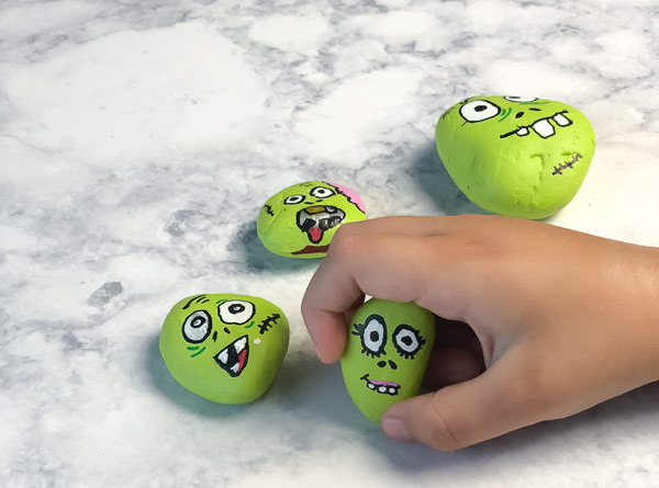 Halloween Craft For Kids | Have your kids make these fun, creepy and cool Zombie painted rocks.