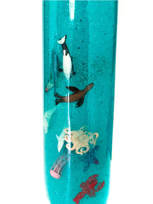 DIY Ocean Sensory Bottle | Make this simple ocean in a bottle with hair gel, glitter, ocean animals and water. #kidsactivities #childrenplay #kidsandparenting #ideasforkids