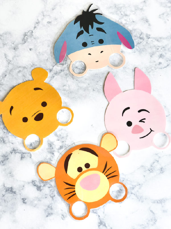 Free Printable Winnie The Pooh Finger Puppets | Kids will love playing with these cute tsum tsum style finger puppets. They're great for imaginative play time. #winniethepooh #christopherrobin #kidsandparenting #kidsactivities #ideasforkids #kidscraft #craftsforkids
