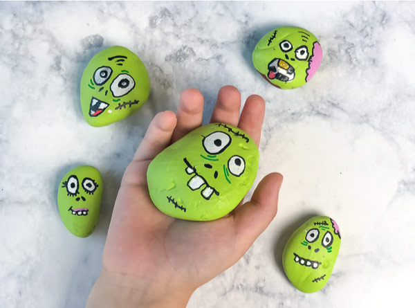Easy Halloween Painted Rocks | Make these fun zombie rocks with this easy tutorial and just a few supplies. #halloween #kidsart #kidsandparenting