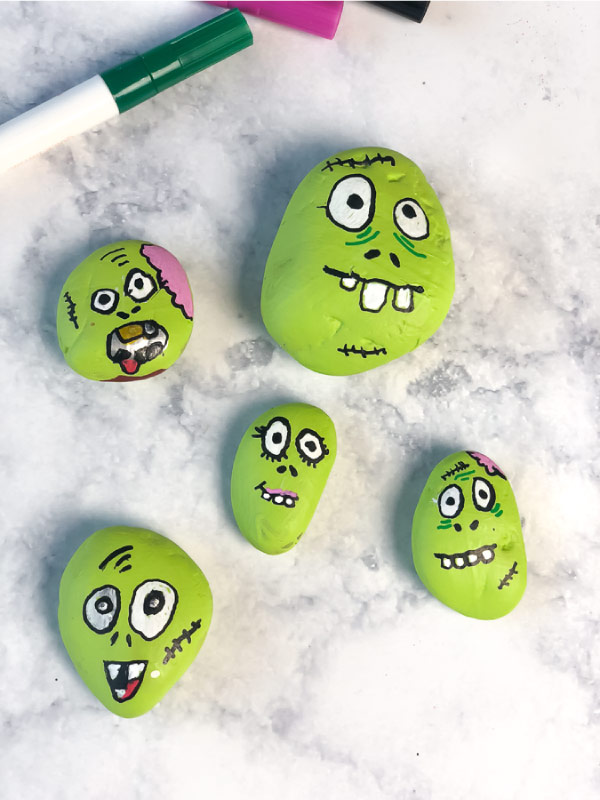 Fun Halloween Idea For Kids | This Halloween season gather the family and make this awesome zombie painted rocks! #halloween #kidsactivities #children #kids #familytime #craftsforkids #kidscrafts