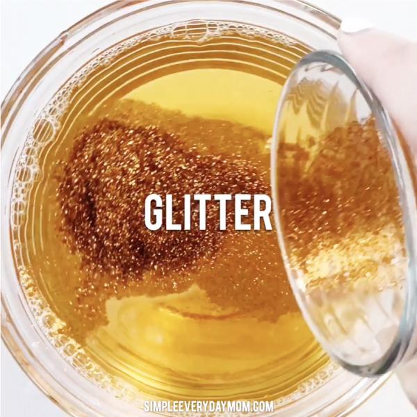 hand pouring glitter into liquid
