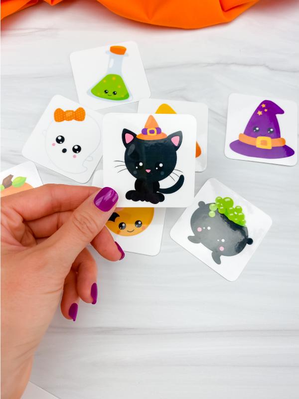 hand holding Halloween memory game card