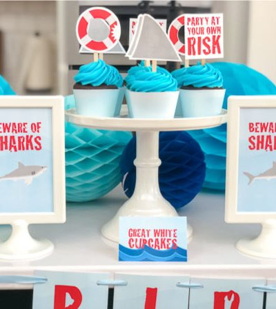 Shark Cupcakes   Use these shark party cupcake toppers to make easy shark themed cupcakes in an instant! #sharkparty #sharks #party #kidsparties #birthday