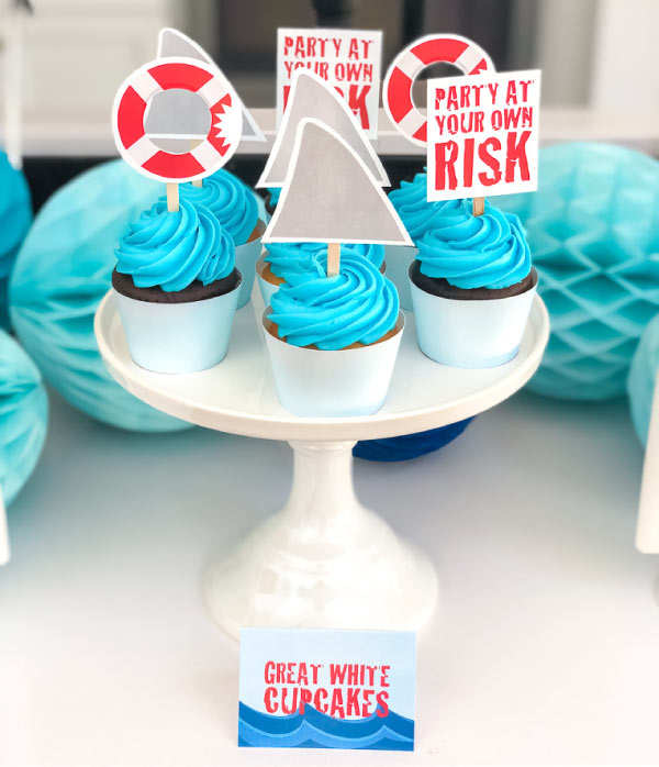 Shark Cupcake Toppers | Throw an awesome and easy DIY shark party with these printable shark cupcake toppers. #themedbirthdayparty #birthdayideas #partyideas #kids #kidsbirthdays