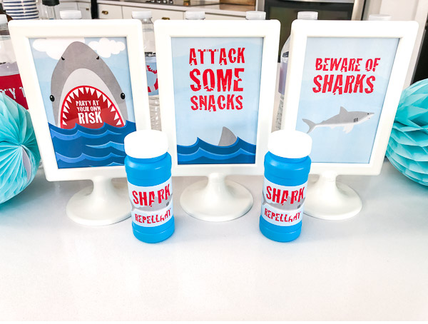 Shark Party Decorations For Kids | Throw an awesome DIY shark party with these cool 4x6 table signs. #sharks #kidsparties #sharkparty