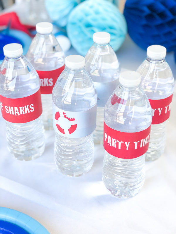 Shark Party Ideas | Transform plain water bottles into decorations with these printable shark themed water bottle labels. #party #printables #kidsparty #sharkparty
