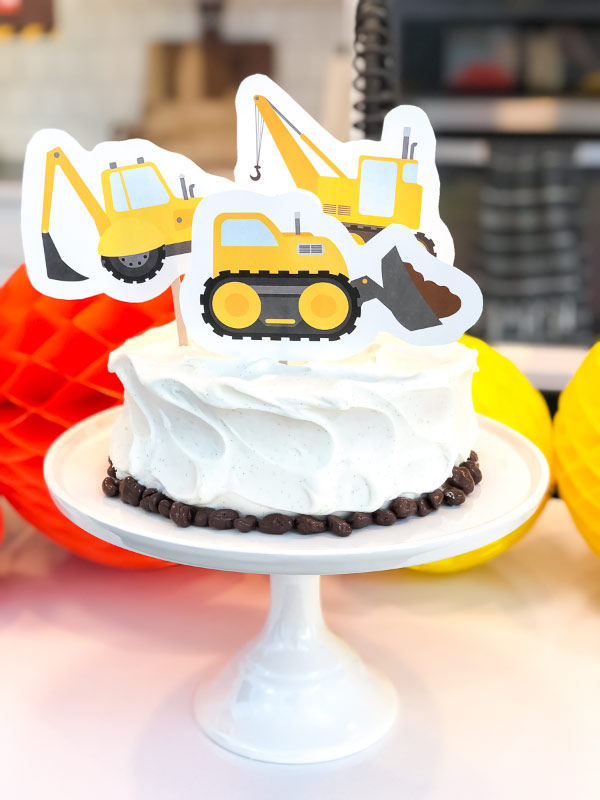 Boys Birthday Cake | Decorate a store bought cake with a these cake toppers and some raisenettes to make an easy and fun cake or smash cake for your little one. #cake #birthdaycake #boys #construction