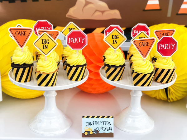 Birthday Cupcakes For Boys | Dress up some store bought cupcakes with these construction themed cupcake toppers and wrappers. It's a simple and fun DIY that's easy to do. #kids #parties #kidsparties