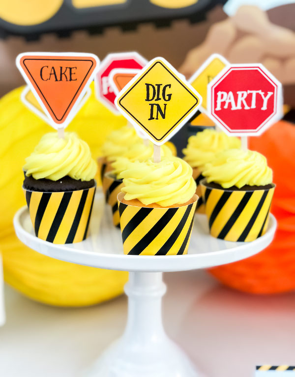 Construction Cupcake Toppers & Wrappers | Boys will love these fun road sign cupcake toppers and wrappers. #kids #boysparty #boybirthday