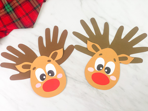 Best Christmas Paper Crafts featured by top Seattle lifestyle blogger, Marcie in Mommyland: Handprint reindeer crafts