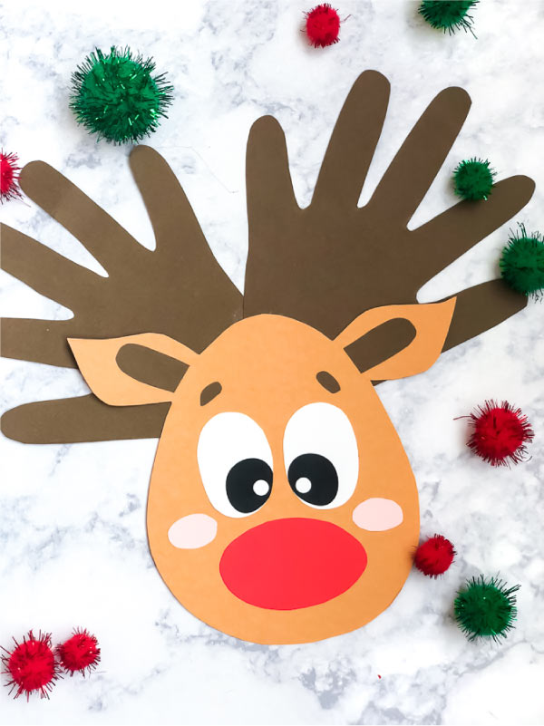 Christmas Crafts For Kids To Make | These handprint Rudolphs are great for making at home, at school or at church this holiday season! #christmas #rudolph #kidscrafts #craftsforkids #kidsandparenting #handprintart