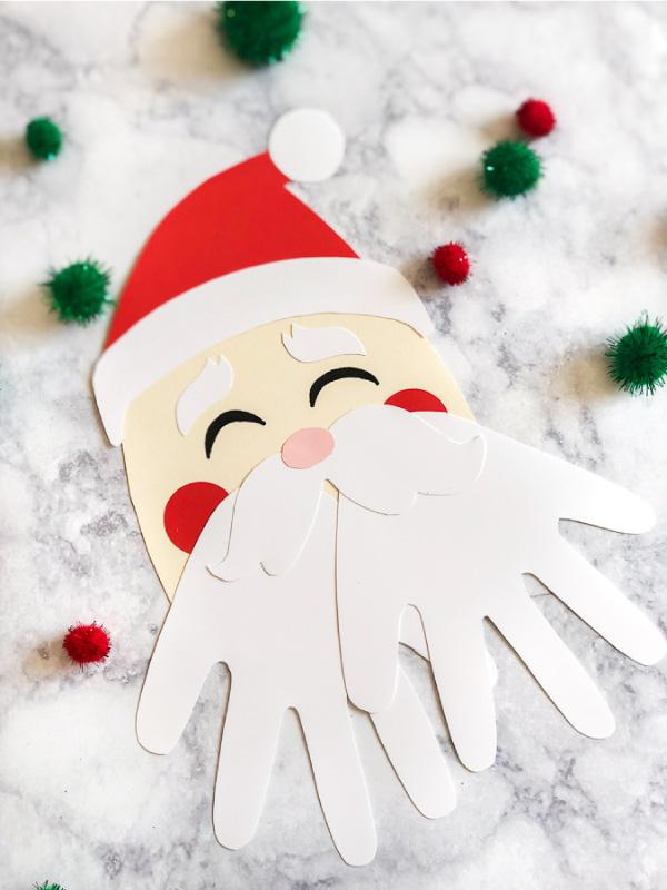Christmas Handprint Art For Kids | Make this cute Santa handprint craft this winter! #christmas #christmascrafts #craftsforkids #kidscrafts #kids