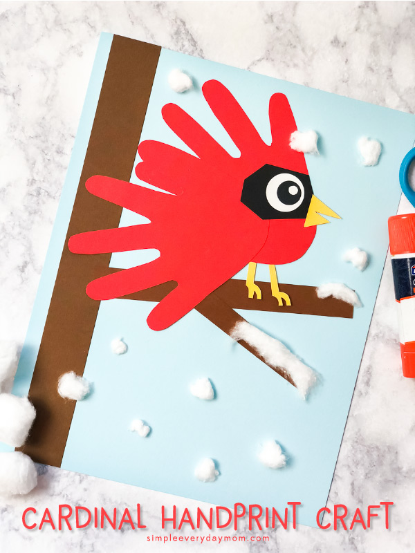Cardinal Handprint Art | Make this cute winter scene with your child's handprint and a few supplies. #kidsactivities #winter #wintercrafts #craftsforkids