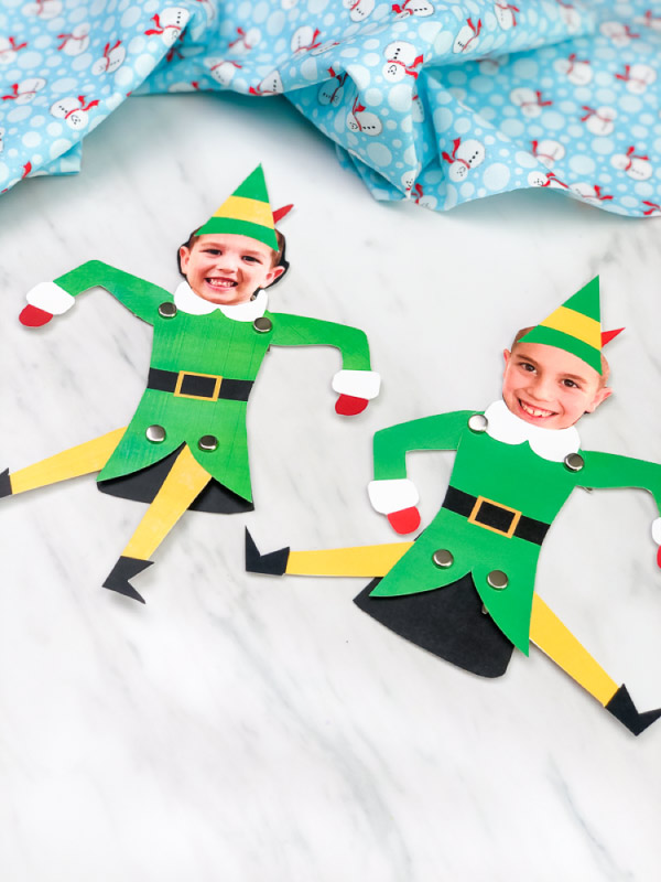 Best Christmas Paper Crafts featured by top Seattle lifestyle blogger, Marcie in Mommyland: 2 buddy the elf kids photo crafts