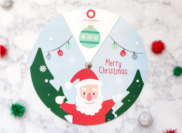 Free Printable Christmas Activity For Kids | Download this free Christmas spinner for a fun and easy activity for kids. #kidscrafts #printablesforkids #craftsforkids