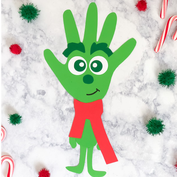Grinch Craft For Kids | Make this fun and easy Grinch handprint craft with the free printable template and your child's handprint. It's cute and a great way to spend time together as families. #kidsactivities #kidscrafts #craftsforkids #ideasforkids #christmasfun #christmasideasforkids