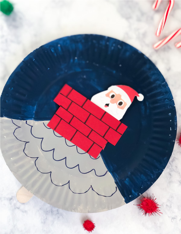 Christmas Paper Plate Craft | Download this free printable Santa and make this fun, movable Christmas craft. #kids #kidsactivities #ideasforkids #kidsandparenting #ece