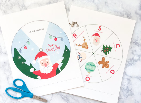 Free Printable Christmas Wheel | Download this free printable Christmas activity for the kids. It's simple and fun! #christmas #christmasactivities #kidscrafts