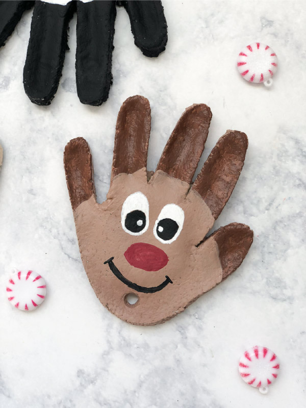 Christmas Salt Dough Ornaments | Make this reindeer handprint ornament this Christmas with just a few supplies. It's a fun Christmas craft for kids they'll love doing! #kids #kidsandparenting #kidscrafts #craftsforkids #kindergarten