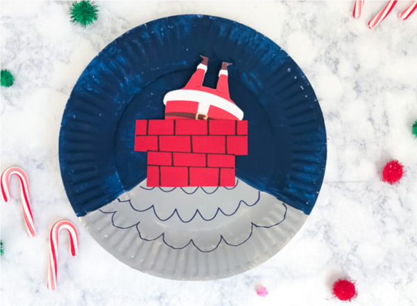Santa Craft For Kids | Mkae this easy and fun Christmas paper plate craft and watch Santa move up and down the chimney! #elementary #kindergarten #paperplatecrafts #kidscrafts #craftsforkids #ideasforkids #ece #preschool