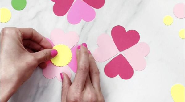 hand gluing flower center to paper flower