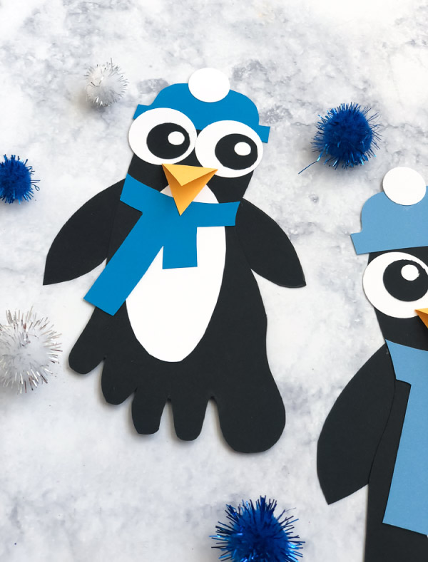 Winter Craft For Kids | Learn how to make these simple penguin footprints. They're perfect for kindergarten or elementary aged kids. #kids #elementary #teachingkindergarten #ideasforkids #kidsandparenting #wintercrafts