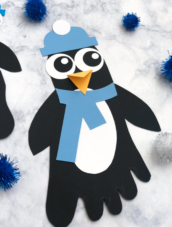 Polar Animal Craft | Kids will have fun at home or in the classroom making these footprint penguin characters. #kids #teaching #teacher #homeschool #kidsactivities #activitiesforkids #children #kidscrafts