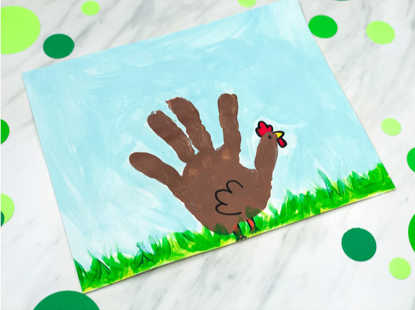 Handprint Craft For Kids | Toddlers, preschool and kindergarten kids will have fun making this chicken art project. It's great for when learning about the farm or for the spring time. #kids #kidsactivities #kidscrafts #craftsforkids #activitiesforkids #ece #earlychildhood #handprintcrafts #springcrafts #farm