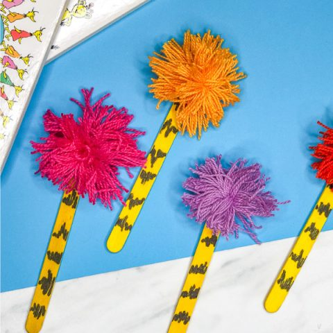 Dr Seuss Craft For Kids | Make this easy popsicle stick truffula tree craft. It's perfect to do at home or in the classroom. #preschool #elementary #kindergarten #teachers #kids #toddlers #kidsactivities #kidscrafts #craftforkids #ideasforkids #drseuss #drseusscrafts #drseussactivities