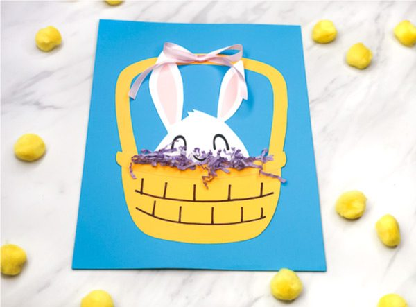 Easter Bunny Craft For Kids | Make this peek a boo Easter craft with some paper, ribbon and Easter grass. It's and easy DIY and comes with a free printable template. #kids #kidscrafts #craftsforkids #ece #earlychildhood #preschool #teachingkindergarten #teacher #classroom #papercraft #easter #eastercrafts #eastercraftsforkids