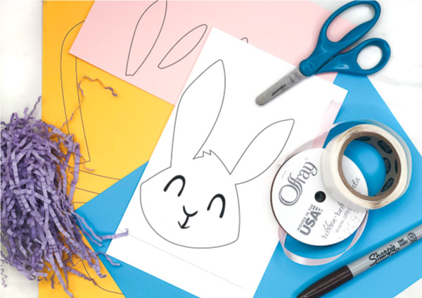 Easter Basket Craft For Kids | Make this easy peek a boo bunny craft with a few simple supplies. Perfect for toddlers, preschoolers and kindergarten children. #easter #easatercrafts #eastercraftsforkids #toddlers #preschoolers #kindergarten #easykidscraft #kidscrafts #craftsforkids #kidsactivities #ece #elementary #classroom #children